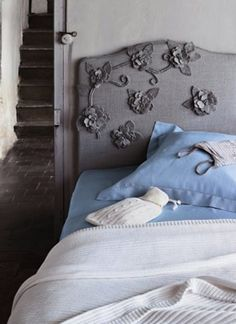 #Bedroom with grey upholstered #bed with floral detailing