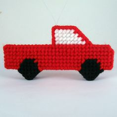 A red pickup truck for Christmas. This delightful freestanding truck makes an interesting and unique travel decoration. Hang it from your Christmas tr Plastic Canvas Letters, Plastic Canvas Stitches, Plastic Canvas Ornaments, Plastic Canvas Crafts, Christmas Truck, Christmas Crafts, Christmas Ornaments, Christmas Decorations, Colorful Baby Showers