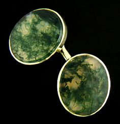 Beautiful antique cufflinks featuring fine Moss Agates with the appearence of dark green seaweed floating in sunlit water.  The oval Moss Agates are set in 14-karat yellow gold. Created by Sansbury & Nellis, circa 1920.