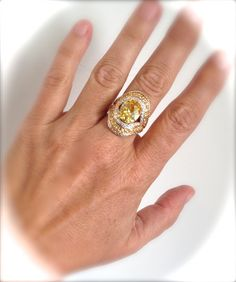 Gorgeous Shimmering Sunny Yellow Center Stone Bordered By Bands Of Twinkling Pave In A Beautifully Contoured Shield Design Will Light Up The