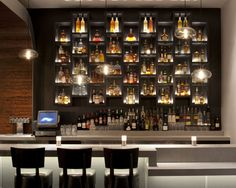 This Bar display beautifully highlights the beverage offerings. I love how the pendent lights are staggered.