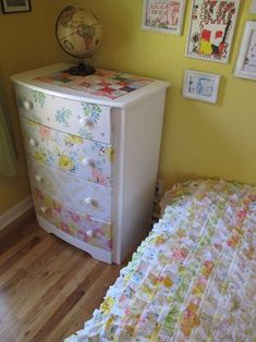 Gorgeous DIY upgraded dresser with vintage sheets to match the vintage sheet quilt. So pretty. <3