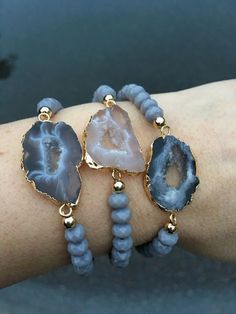 Stretchy bracelets choose from numbered photo. Agate Druzy sliced with gold and silver electroplated edge and grey glass beads. Fits small to medium. Will come in gift box #JewelryIdeas