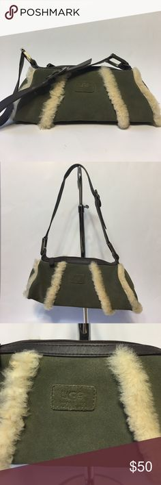 """Ugg Australia Baguette Barrel handbag This is an Ugg Australia Baguette Barrel handbag/purse. It is olive green in color. It has a zipper on the top and strap that is brown with bronze color hardware. The strap is adjustable. It measures about 13"""" long x 5"""" tall (not including strap) x 3"""" wide. The max strap drop is about 11"""". Label and buckle are marked Ugg Australia. Hardware rings are marked Ugg. It is in really good condition. UGG Bags Shoulder Bags"""