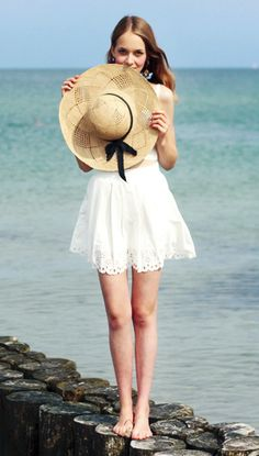 Such a sweet look! Classic floppy hat with adorable summer dress.