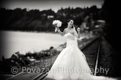 SFU Diamond Alumni wedding by Povazan Photography creative portrait pictures at White Rock pier with bride and groom and bridal party