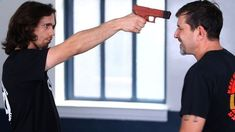 How to Defend against a Gun to the Face | Krav Maga Defensehttp://www.howcast.com/videos/509338-How-to-Defend-against-a-Gun-to-the-Face-Krav-Maga-Defense