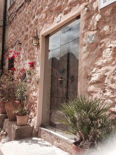 Preservation of beautiful old doors behind new glass doors- Casa de mi Tia en Fornalutx