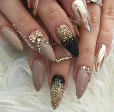 gold nails. Stiletto nails.