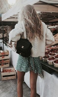 for love and lemons fringe sweaters + chanel quilted backpacks + floral flounce mini skirts + beachy sunkissed blonde balayage hair