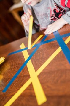 Tape to Strengthen Little Fingers Peel tape off the table (fine motor skills!)Peel tape off the table (fine motor skills! Fine Motor Activities For Kids, Motor Skills Activities, Gross Motor Skills, Preschool Learning, Sensory Activities, Therapy Activities, Early Learning, Learning Activities, Preschool Activities