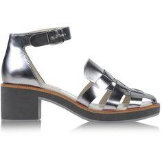 Laminated effect. Buckling ankle strap closure. Rubber sole. Square heel. Protective shoe bag. Material:Calf-skin leather
