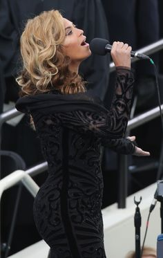 Beyonce wears an Emilio Pucci black velvet and chiffon beaded cutout long-sleeved gown from the Pre-Fall 2013 collection to perform the National Anthem at the public ceremonial inauguration for the U.S. President Barack Obama on the West Front of the U.S. Capitol