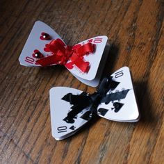 alice in wonderland party - hair bows $10 OR! get a deck of cards and some ribbon to make them yourself!