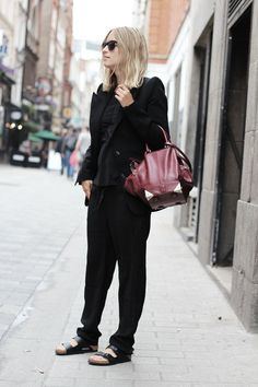 Charlotte The Fashionguitar fashion blogger wearing birkenstocks slouchy pants celine streetstyle