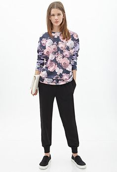 Reminiscent of Carven's marbly color palette and so many muted florals, this sweatshirt fits in the seasonal hues and carries forward the sportswear fashion trend. $17.90 Rose Print Sweatshirt | FOREVER21 - 2000056609
