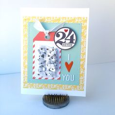 I Love You 24 Seven!, card by Katherine Maynard using the Pop Fizz collection from www.cocoadaisy.com #cocoadaisy #scrapbooking #kitclub #cards #stitching #tags #diecuts #fringe #tissue #recycle