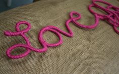 Awesome DIY for making yarn covered words.  I totally want to do this with my store logo!!  And maybe my puppy's name, or my shop name, the possibilities are endless!