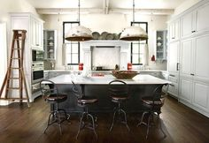 Love this modern industrial style. Even the old ladder in the kitchen is cool!