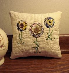 Old quilt pillow idea...something to do with my collection of old, frayed quilts!