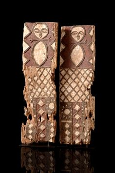 Africa   Two door panels from the Tsogho people of Gabon   Light wood, with polychorme paint