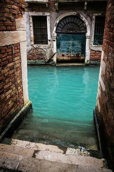 Turquoise Canal in Venice, Italy