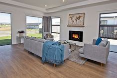 Cosy Living Room | Gas Fire | Fireplace | Grey Sofas | Hint of Blue | Beautiful Wooden Floors Grey Sofas, Gas Fires, Wooden Flooring, Living Room Inspiration, Cosy, Floors, Layout, Blue, Beautiful