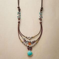 """COMPENDIUM NECKLACE--Our handcrafted leather, sterling bead and gemstone necklace is a compendium of colorful gems and sterling silver beads, bedecking a leather cord. A handmade exclusive with turquoise, garnets and more. Slide adjusts length from 18"""" to 28""""L."""