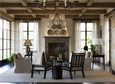 love the boxed beam ceiling and slipcovered furniture mixed with wood