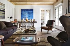 Hans Wegner ottoman in Private Residence, East Hampton, NY by Robert Stilin, LLC