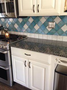 Caledonia granite, rustoleum quilters white cabinet finish, blue backsplash