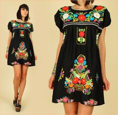 Love, Love, Love this!! ViNtAgE 70's Black Rainbow Floral Hand Embroidered Mexican MiNi Dress Tunic at hellhoundvintage.etsy.com.