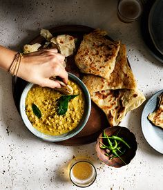 We've made this curry to have as a dipping sauce with roti, but it could also be served as a meal with rice. Start this recipe a day ahead to make the roti.