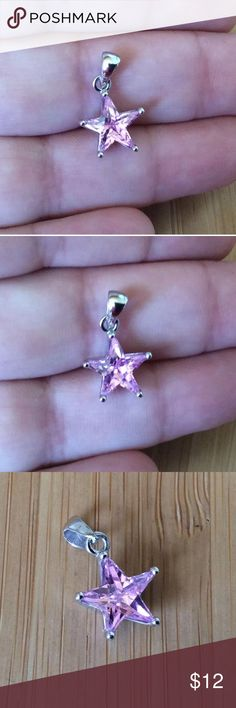 925sterlingsilver star pendant pink cubic zirconia Description:  Metal Type: 925 Sterling Silver   Metal Finish: High Polish, Rhodium Plated  Center Gem type: Aqua/ pink Cubic Zirconia  Jewelry Type: Pendant  Center Gem Shape: Star   Shop by Design: Modern   Specifically for: Women  Center Gem Color: Aqua/pink  Height: 14.2 mm (0.6 in)  Width: 11.8 mm (0.5in)  Weight: 1.4 grams  Stamped 925 Sterling Silver Jewelry Necklaces