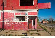 Detroit, Michigan - An abandoned laundry and dry cleaners in a depopulated section of Detroit's east side. - Stock Image