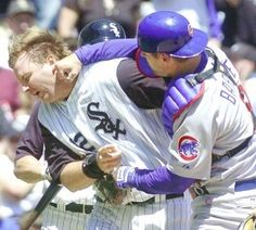 Michael Barrett, Chicago Cubs, shows his displeasure at A. Pierzynski, Chicago White Sox, by punching him in the face. Chicago Cubs, Chicago Baseball, Chicago White Sox, Chicago Blackhawks, Blackhawks News, Baseball Fight, Baseball Memes, Cubs Baseball, Angels Baseball