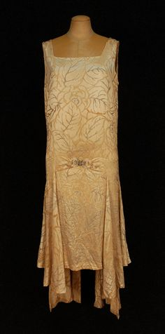 """Evening Dress, Molyneux, France: 1920's, beaded silk, gores joined in front by jeweled buckle, allover decorated with pearls and crystal beads.    Label: """"Modele Molyneux 5, Rue Royale"""""""