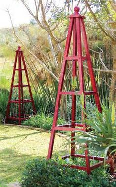 These pyramid-shaped trellises are attractive décor items, elegant ...
