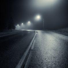 Street lights in the nighttime fog