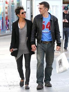 Halle Berry is spot on in an asymmetrical top, oversized black jacket, leather leggings and black flats with a contrasting black panel. Get the look in the Gentle Souls 'Iso Kix'!