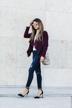 Pam Hetlinger dresses up a casual jeans and coat look by pairing it with sleek black stilettos for a sexy and elegant finish. A pair of shades and minimalist accessories are the perfect match to this look. Jacket: Shopbop, Jeans: Bloomingdales.