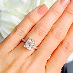 Radiant cut French setting engagement ring
