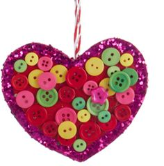 From the Bohemian Holiday Collection This delightfully simplistic ornament features a charming heart embellished with pink glitter and adorned with colorful