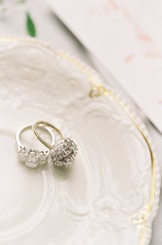 Two diamond rings that are stunners: http://www.stylemepretty.com/little-black-book-blog/2017/01/09/al-fresco-seaside-summer-wedding/ Photography: Michael and Carina - http://www.michaelandcarina.com/