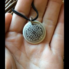 Celtic Knot Artsy Clay Circle Pendent Irish Cross Interlocking brown ink even cross design on a white circle. Black string for necklace. Saint Patrick's. Religious. Catholic. Goddess. Bridget. Catholic. Fire dancer. Bohemian chic. Fairy festival. Mid evil cosplay. Priestess. Henna like. Irish. Saint Patrick's day. Vintage Jewelry Necklaces