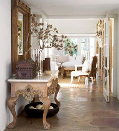 Michele Throssell Interiors > entrance hall > stone floors > wood and marble server South African Decor, South African Design, Entrance Hall, Stone Flooring, Dining Table, Dining Room, Beautiful Homes, Interiors, Spanish Colonial