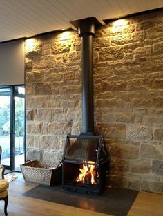 Beautiful installation against stone wall. Radiante 700 with unique lift up and lateral opening door.
