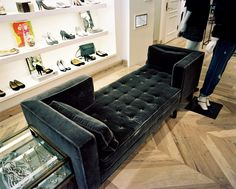 Retail Store Design Photo - A two-sided tufted bench beside a display of shoes and jewelry alongside