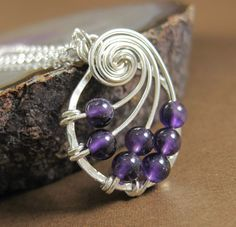 Amethyst Fibonacci Nautilus Necklace Sterling Silver Wire Wrapped Jewelry. $55.00, via Etsy.