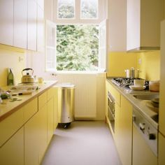 Get pictures and ideas about modern small kitchen design for designing and remodeling your tiny kitchen. Open small kitchen,U shaped kithen Yellow Kitchen Interior, Yellow Kitchen Cabinets, Yellow Kitchen Designs, Kitchen Yellow, Yellow Kitchens, Lemon Kitchen, Kitchen Colors, Brown Cabinets, Small Kitchen Cabinet Design